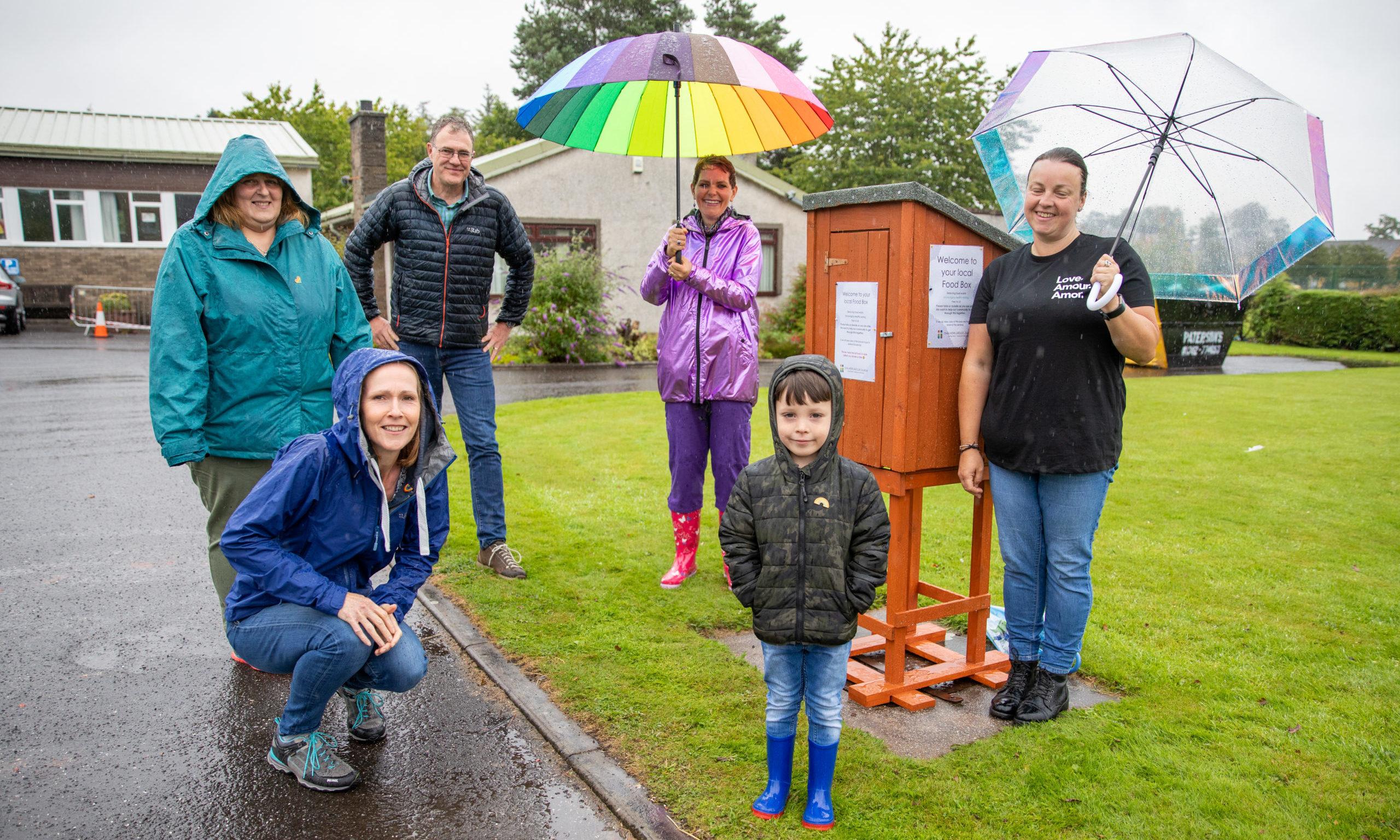 Back row from left: Sheona Chisholm,  Rev Jonathan Humphrey, Melanie Jane Harrison and Glenda Watt. Front; Kate Humphrey and Cohenn Watt, at the community food box.