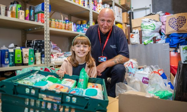 Tam McGeary, janitor at Tayview Primary School and his daughter Erin who has been instrumental in the charity work - he has been organising food, toy, toiletries donations during the pandemic to those in need.
