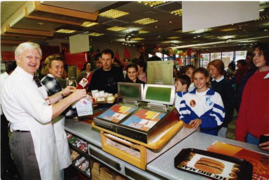 Liz McColgan and George Duffus at McDonalds for charity.