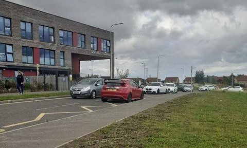 Cars at North East Campus parked dangerously in 'no stopping' areas.