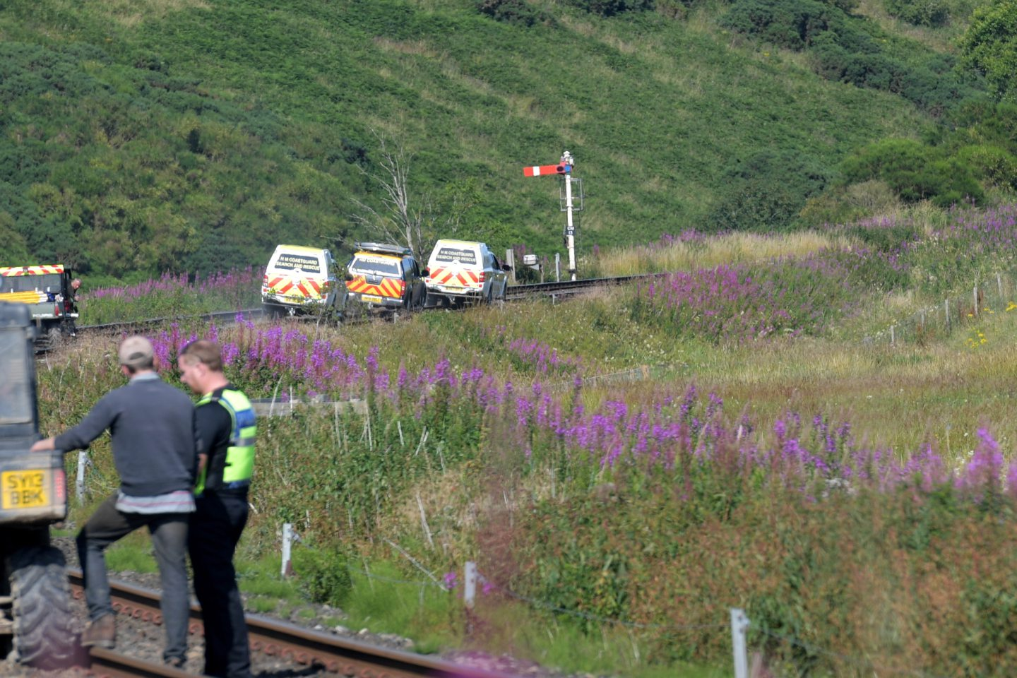 Coastguard teams drive onto the tracks at Carmont signal box.