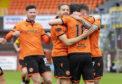 Dundee United's players celebrate Nicky Clark's opener against St Johnstone