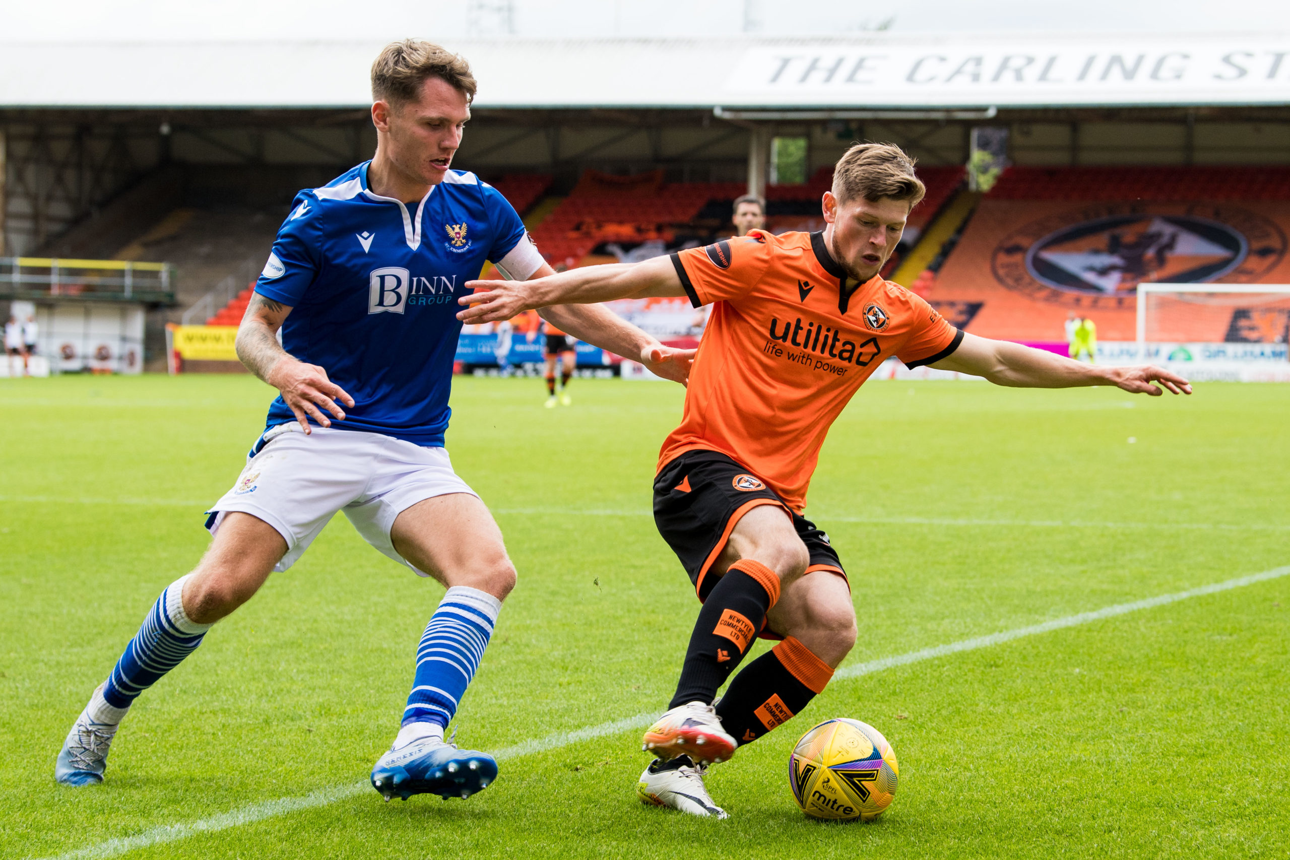 Cammy Smith up against St Johnstone's Jason Kerr on the opening day of the season.