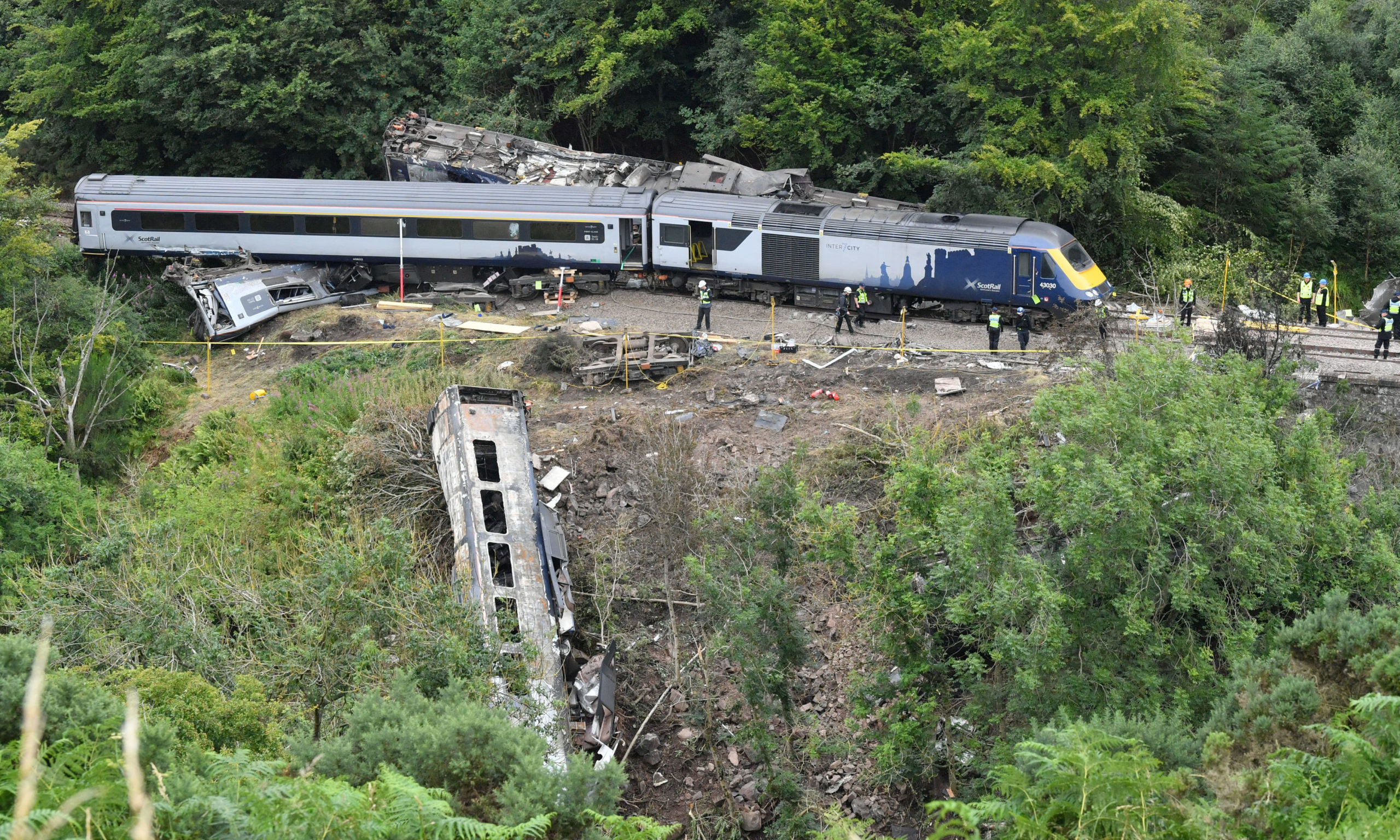 The scene near Stonehaven, Aberdeenshire, following the derailment of the ScotRail train which cost the lives of three people on Wednesday.