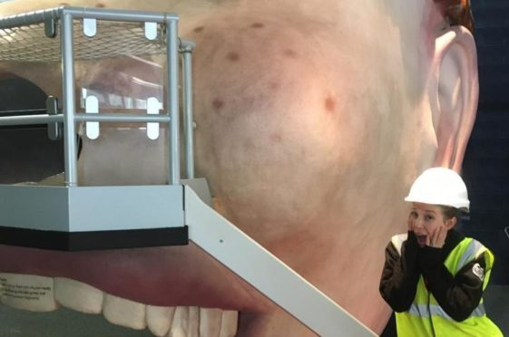 Construction work has begun at Dundee Science Centre with the giant head being removed.