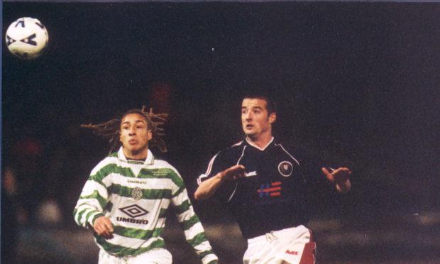 Former Dundee defender Dave Rogers keeps an eye on Celtics Henrik Larsson.