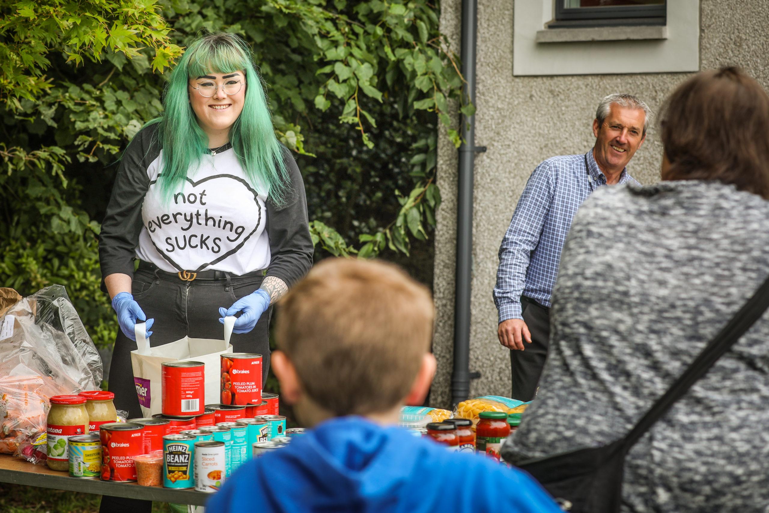 Volunteers handing out food at the Menzieshill Food Larder during lockdown