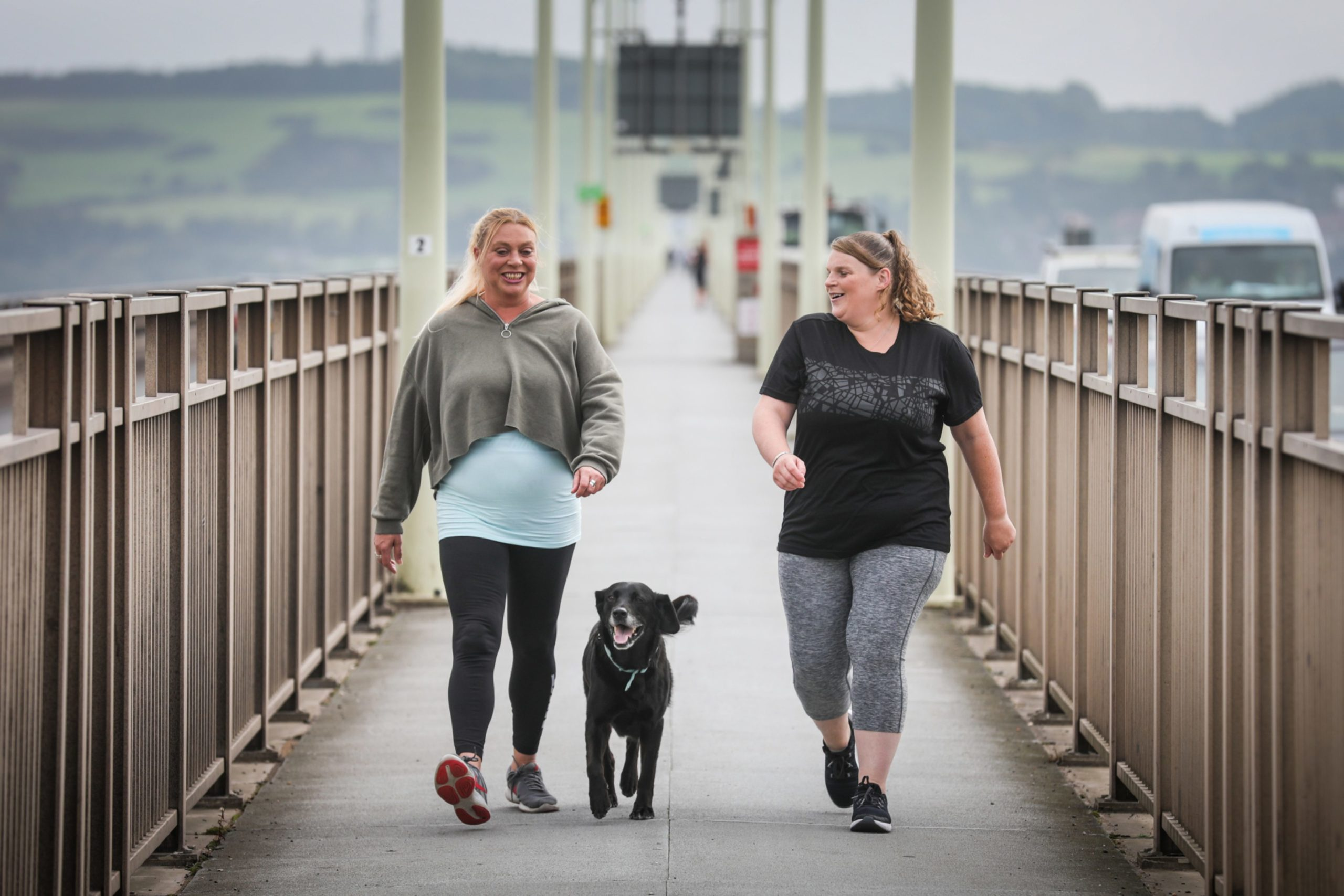Valerie Lindsay and Chez Lesley are to be leading a sponsored walk from the Tay Bridge to the Forth Road Bridge on August 29 in aid of Andy's Man Club. Here the pair are with 14-year-old labrador Skip who will walk with them. (Picture: Mhairi Edwards/DCT Media)
