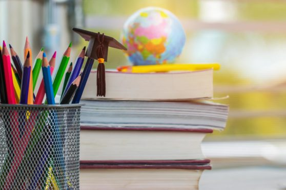 Education Graduate study concept: Black Graduation hat on pencils, blur of europe earth world globe on stack textbook at university classroom. Ideas knowledge learning success, Back to School; Shutterstock ID 1285524043; Purchase Order: -