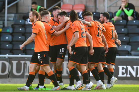 Lawrence Shankland is congratulated by his teammates.