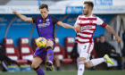 Lawrence Shankland (left) competes with Scott McMann the last time United faced Hamilton.