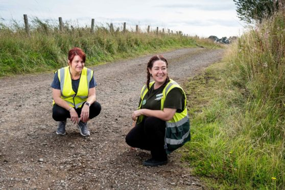 Nikki Warwick and her friend Mandy Munro tidying up the fly-tipping. Picture by Paul Reid.
