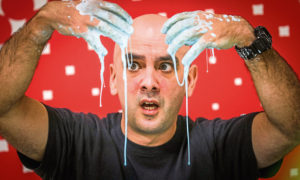 Jamie Strachan from Dundee Science Centre demonstrating the slime experiment.