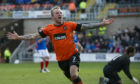 Johnny Russell celebrates scoring for Dundee United against Rangers in 2013.