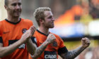 Sean Dillon (left) and Johnny Russell celebrate their cup win over Rangers in 2013.