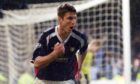 John Sutton wheels away after scoring the winner in the Dundee derby in November 2004.