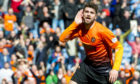 Striker celebrates goal against Rangers in 2014 Scottish Cup Final.