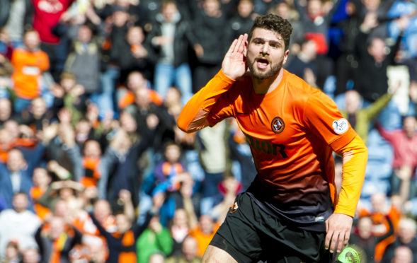 Striker celebrates goal against Rangers in 2014 Scottish Cup Final.