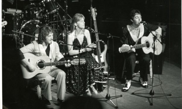 Wings perform in Dundee in 1975.