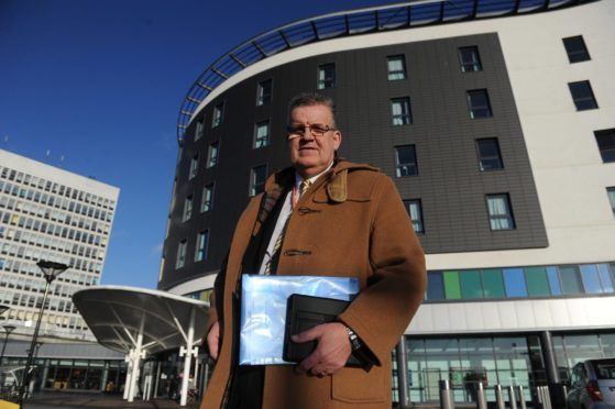 Kim Cessford, The Courier - 24.12.15 - pictured outside the front entrance to the Victoria Hospital, Kirkcaldy is Cllr Andrew Rodger - to go with story about delayed discharges.