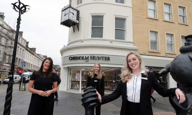 Stef Lindsay, manageress at Chisholm Hunter jewellers, in the old H.Samuel shop Dundee city centre, are keeping and restoring the iconic clock.