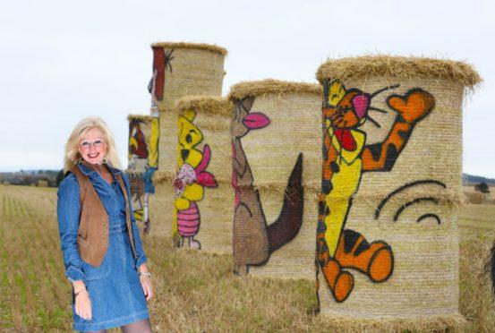 "Angus artist Fleur Baxter with her ""Winnie the Poo"" hay bales."