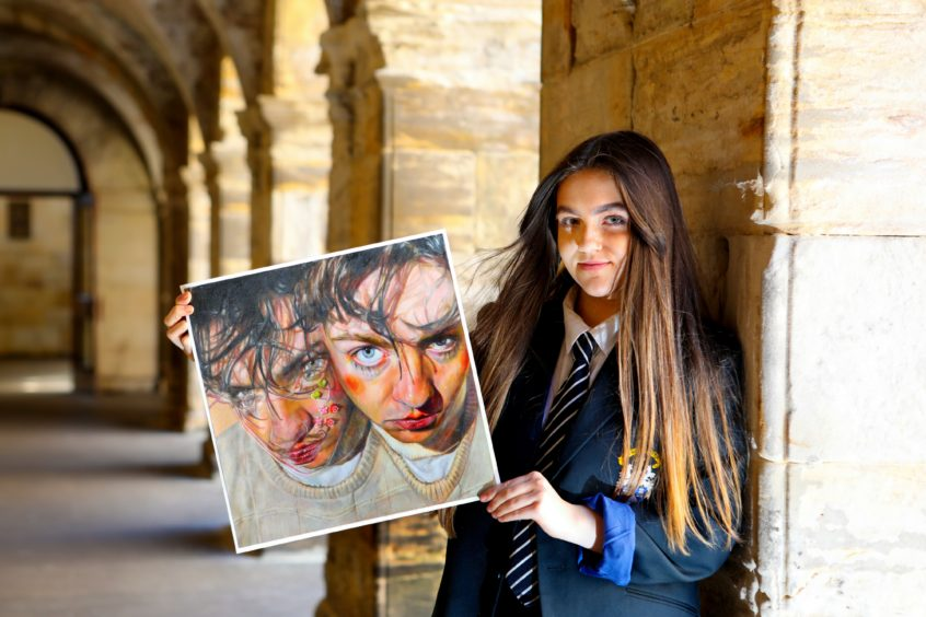 """Sixteen-year-old Madras College student Amy McLean with her painting entitled """" Jack"""" which has been long listed for the Scottish Portrait of the Year 2020"""