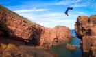 Cliff diving has soared in popularity.