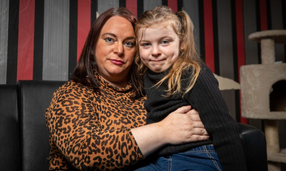 Leanne Campbell and daughter and Ava Craig, 7, at home, following the terrifying attack in Dundee city centre on Friday. Picture by Kim Cessford / DCT Media