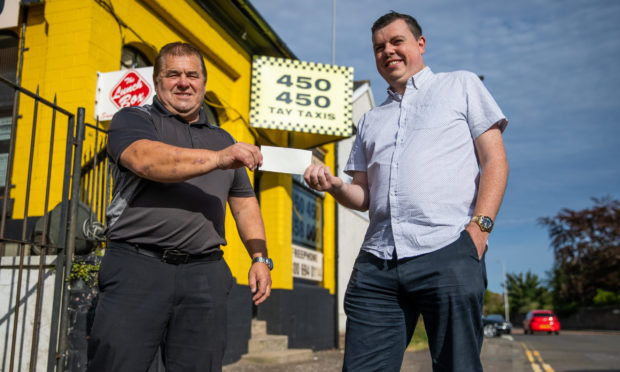 Charlie Duthie, left, and Simon Redmond with the cheque for the funds raised in their appeal to replace a stolen bicycle. Picture by Kim Cessford / DCT Media