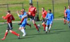 Barnhill (blue) in action against Menzieshill last season.
