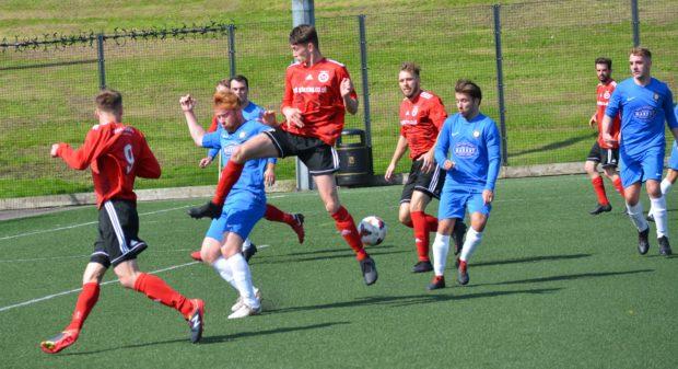 Barnhill (blue) in action against Menzieshill last season.