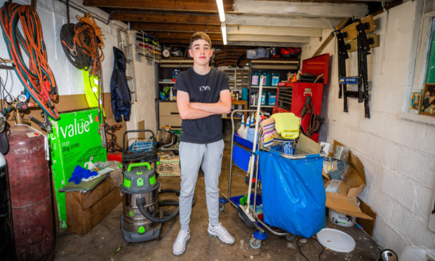 Chris McDonell, 15, has set up own valet servcie from his home in Dundee - AR Valets. Picture by Steve MacDougall / DCT Media.