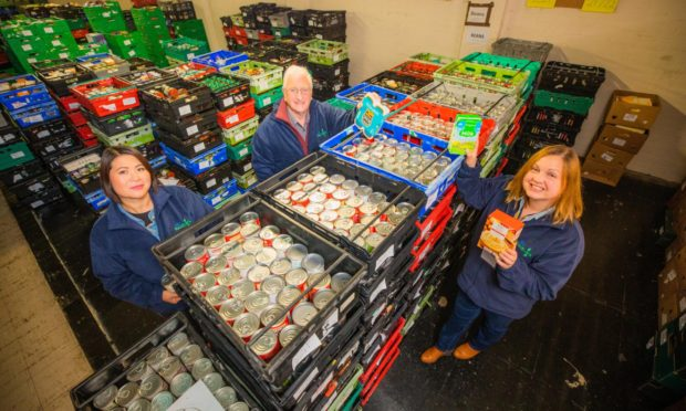 Ping Mennie (volunteer), Michael Archibald (chairman) and Lynn-Marie Neil (one of the coordinators). at Perth and Kinross Foodbank,