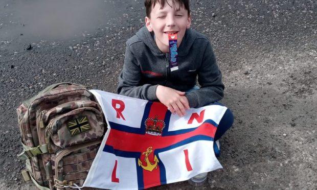Charlie Watts with an RNLI flag.