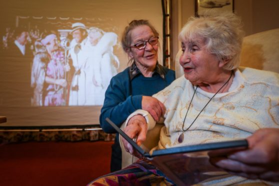 Mary Cavin, Co-ordinator at Golden Oldies with Irene Dowie, 92, at one of the mobile cinema sessions at Carmichael House earlier in the year.