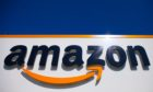 Mandatory Credit: Photo by Michel Spingler/AP/Shutterstock (10757861a) The Amazon logo is seen in Douai, northern France. Amazon started selling a wrist band Thursday, Aug. 27, 2020, that tracks workouts, sleep and body fat. It can also listen to your voice all day and tell you when you sounded happy or sad Amazon Fitness Tracker, Douai, France - 16 Apr 2020