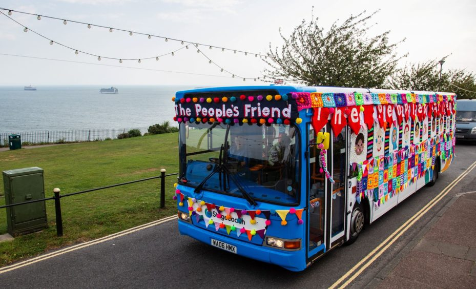 The colourful coach cruises along. Photo courtesy of Wire.