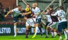Dundee and Hearts players battle for the ball inside the Dark Blues' box in Friday's first half.