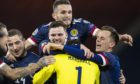 Scotland stars celebrate shoot-out victory.