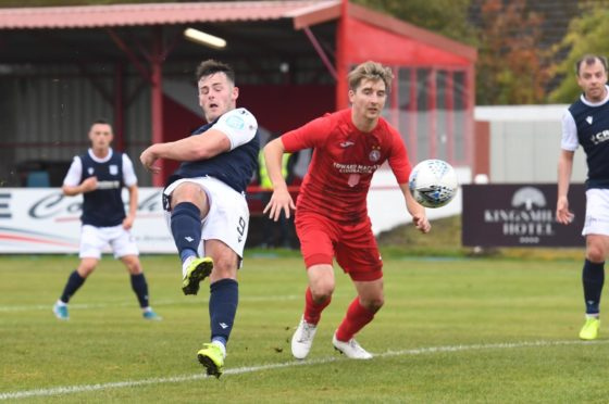 Danny Mullen scores to make it 2-0 for Dundee on his debut at Brora Rangers.