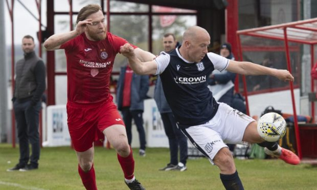 Charlie Adam made his competitive debut for Dundee in Brora last weekend.