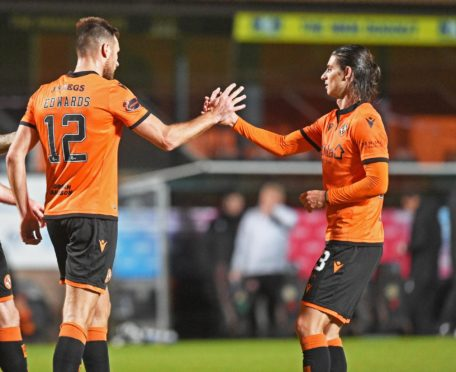 Ryan Edwards (centre) celebrates with Ian Harkes after Dundee United took the lead against Kelty Hearts.