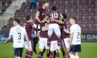 Hearts celebrate Michael Smith's opening against Dundee.