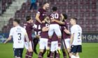 The Hearts' squad celebrate Michael Smith's opening goal in their 6-2 win over Dundee on Friday.