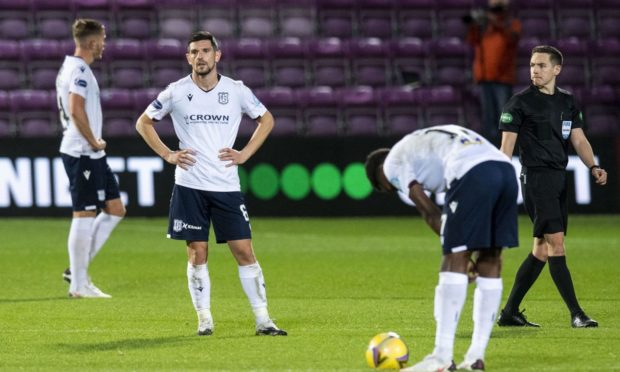 Dundee's Graham Dorrans (centre) during match against Hearts at Tynecastle.