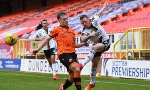 Dundee United winger Luke Bolton closes down Aberdeen man Jonny Hayes.