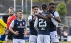 Dundee's  Jonathan Afolabi (right) celebrates after he makes it 1-0 against Morton.