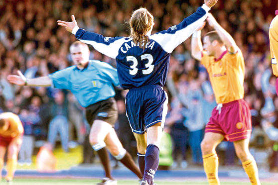 Argentinian ace Claudio Caniggia celebrates after netting for Dundee.