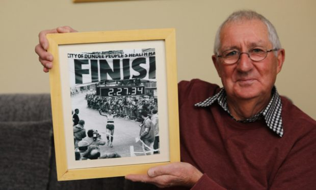 Sam Graves with a photo of himself winning the 1988 Dundee Marathon, at home in Broughty Ferry.